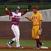 5-23-18<br /> Kokomo vs McCutcheon baseball<br /> Jack Perkins gets pumped up after making the first hit for the Wildkats.<br /> Kelly Lafferty Gerber | Kokomo Tribune