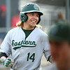 5-1-18<br /> Taylor vs Eastern baseball<br /> Eastern's Eli Elkins grins as he heads back to the dugout after hitting a homerun.<br /> Kelly Lafferty Gerber | Kokomo Tribune
