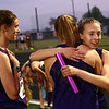 5-15-18<br /> Girls track and field sectional<br /> Joan Easter hugs teammates after NW wins the 4x400 relay.<br /> Kelly Lafferty Gerber | Kokomo Tribune