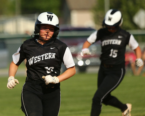 5-9-18<br /> Eastern vs Western softball<br /> Western's Chase Epp heads for third and home after her teammate hits a grand slam.<br /> Kelly Lafferty Gerber   Kokomo Tribune