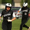 5-9-18<br /> Eastern vs Western softball<br /> Western's Chase Epp heads for third and home after her teammate hits a grand slam.<br /> Kelly Lafferty Gerber | Kokomo Tribune