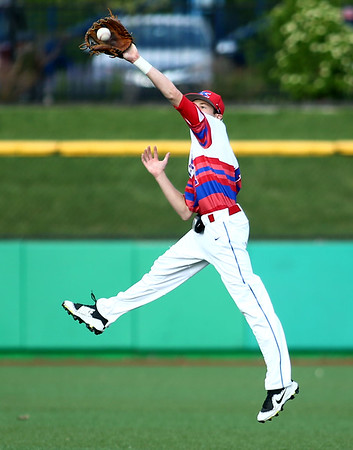 5-25-18<br /> Kokomo vs Harrison baseball<br /> Payton McClain hops up to grab the ball after the hit bounces off the turf.<br /> Kelly Lafferty Gerber | Kokomo Tribune