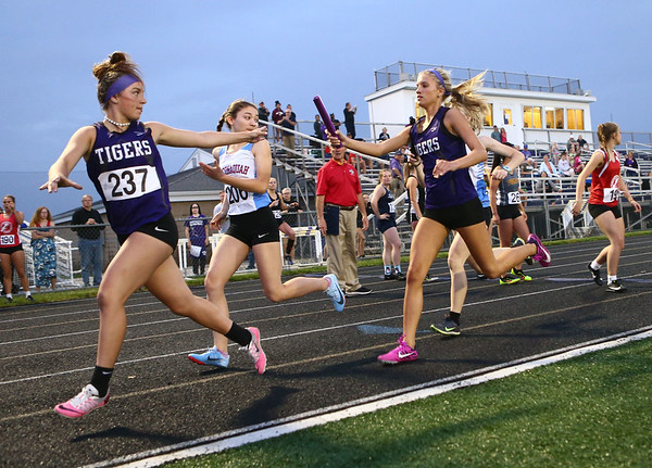 5-15-18<br /> Girls track and field sectional<br /> NW's Kaylee Watson hands off to JoHannah Hetzner in the 4x400 relay.<br /> Kelly Lafferty Gerber   Kokomo Tribune