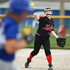 5-3-18<br /> Taylor vs Carroll softball<br /> Maddie Uncapher tosses to first for the out.<br /> Kelly Lafferty Gerber | Kokomo Tribune