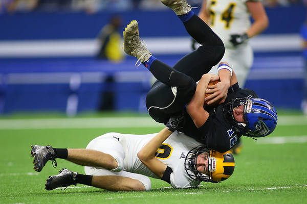 Pioneer's Brenon Mersch brings down North Vermillion's Wyatt Reynolds to beat them in the Class A State Finals 60-0 on Nov. 24, 2018 at Lucas Oil Stadium.<br /> Tim Bath | Kokomo Tribune