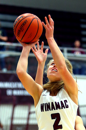 Jillian Brumm shoots another 2 pointer from under the basket during girls basketball between Winamac HS and Cass HS on Nov. 10, 2018. <br /> Tim Bath   Pharos Tribune