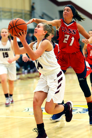 Winamac's Hailey Sanders puts up a shot dispite Cass's Miah Martin's effort to stop her during girls basketball between Winamac HS and Cass HS on Nov. 10, 2018. <br /> Tim Bath   Pharos Tribune