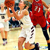 Winamac's Hailey Sanders puts up a shot dispite Cass's Miah Martin's effort to stop her during girls basketball between Winamac HS and Cass HS on Nov. 10, 2018. <br /> Tim Bath | Pharos Tribune