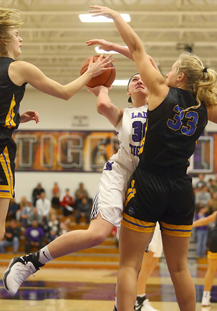 11-10-18<br /> Northwestern vs Carmel girls basketball<br /> Steph Burns is fouled as she puts up a shot.<br /> Kelly Lafferty Gerber | Kokomo Tribune