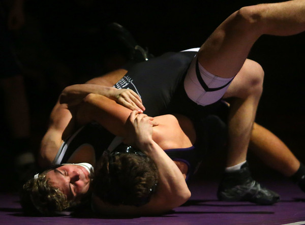 11-28-18<br /> Western vs Northwestern wrestling<br /> Western's Carter Ciscell takes down NW's Brayden Scering in the 152.<br /> Kelly Lafferty Gerber | Kokomo Tribune