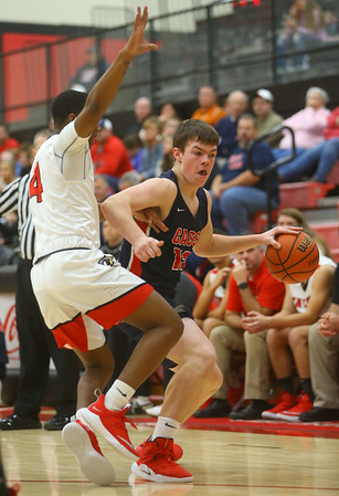 11-27-18<br /> Taylor vs Lewis Cass boys basketball<br /> LC's Isaac Chambers dribbles down the court.<br /> Kelly Lafferty Gerber | Kokomo Tribune