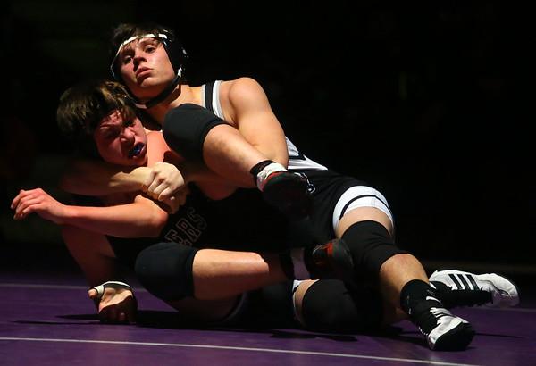 11-28-18<br /> Western vs Northwestern wrestling<br /> Western's Luke Lechner takes down NW's Nolan Floyd in the 170.<br /> Kelly Lafferty Gerber | Kokomo Tribune