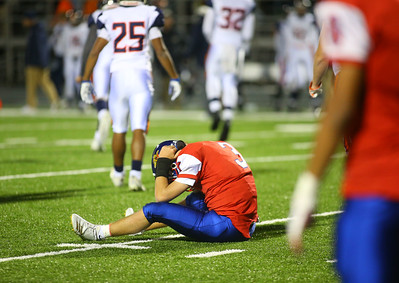 11-2-18 Kokomo vs Harrison sectional championship Levi Hrabos sits on the field after a bad snap led him to get sacked during an extra point attempt. Kelly Lafferty Gerber   Kokomo Tribune