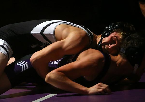 11-28-18<br /> Western vs Northwestern wrestling<br /> Western's Hunter Cottingham takes down NW's Tommy Lunsford in the 132.<br /> Kelly Lafferty Gerber | Kokomo Tribune
