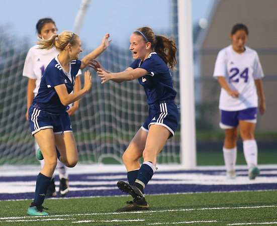 10-2-18<br /> Northwestern vs Lafayette Central Catholic girls soccer sectional<br /> LCC's Aubrey Weeks, right, rushes up to hug teammate Lauren Hack after Hack scored the third goal of the game.<br /> Kelly Lafferty Gerber | Kokomo Tribune