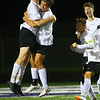 Western HS boys soccer team defeated Northwestern's 2-1 during the sectional final on Oct. 6, 2018. Max Harbaugh celebrates hugging Nathan Tuchscherer after sending the first goal in, to tie the game.<br /> Tim Bath | Kokomo Tribune