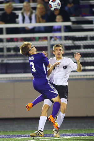 Western HS boys soccer team defeated Northwestern's 2-1 during the sectional final on Oct. 6, 2018. Northwestern's Elijah Collins and Western's Noah Stranahan collide with Collins getting a yellow card.<br /> Tim Bath   Kokomo Tribune