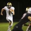 Friday night football between Eastern HS and Sheridan HS on Oct. 5, 2018. Eastern' s quarterback Garrett Hetzner on a keeper.<br /> Tim Bath | Kokomo Tribune
