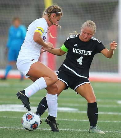 10-6-18 Western vs Marion girls soccer sectional championship Western's Faith Lytle works to get control of the ball over Marion's Kathryn Erickson. Kelly Lafferty Gerber | Kokomo Tribune