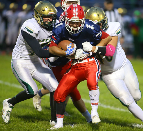 10-19-18<br /> Cass vs Eastern football<br /> Eastern's Garrett Hetzner and Luke Monize take down Cass' Caden Zeck.<br /> Kelly Lafferty Gerber | Kokomo Tribune