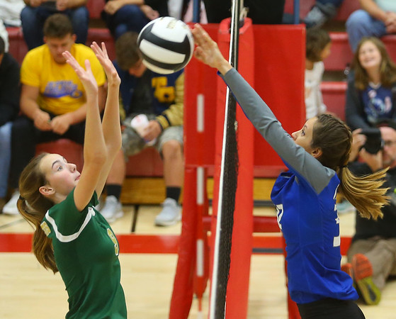 10-11-18<br /> Eastern vs Tipton volleyball<br /> Tipton's Cassidy Crawford tips it over to Eastern's Loralei Evans.<br /> Kelly Lafferty Gerber | Kokomo Tribune