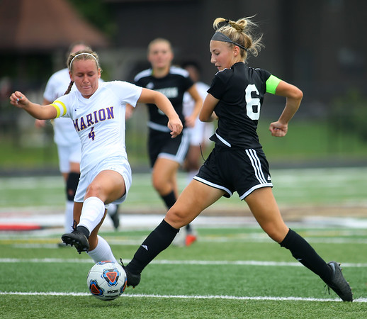 10-6-18 Western vs Marion girls soccer sectional championship Western's Sophie Weigt makes it to the ball before Marion's Kathryn Erickson. Kelly Lafferty Gerber | Kokomo Tribune
