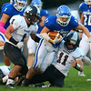 10-5-18<br /> Tipton vs Western football<br /> Tipton's Peyton Carter carries the ball as he tries to get by Western's Evan Shaw (1) and Gage Holder.<br /> Kelly Lafferty Gerber | Kokomo Tribune
