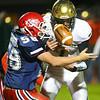 10-19-18<br /> Cass vs Eastern football<br /> Eastern's Garrett Hetzner fumbles the fall after he gets hit by Cass' Joe Shaffer.<br /> Kelly Lafferty Gerber | Kokomo Tribune