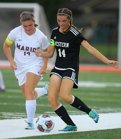 10-6-18 Western vs Marion girls soccer sectional championship Western's Alexandra Parr, right, and Marion's Moriah Shigley go after the ball. Kelly Lafferty Gerber | Kokomo Tribune