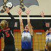 10-20-18<br /> Tipton vs Clinton Prairie regional volleyball semi-final<br /> Tipton's Lauren Shively and Rachael Ressler put up a block against CP's Kylee Maish.<br /> Kelly Lafferty Gerber | Kokomo Tribune