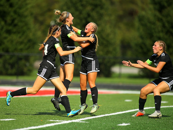 10-6-18<br /> Western vs Marion girls soccer sectional championship<br /> Western's Sophie Weigt (second from left) celebrates with teammates after scoring the her first goal and the Panthers' second goal of the game.<br /> Kelly Lafferty Gerber | Kokomo Tribune