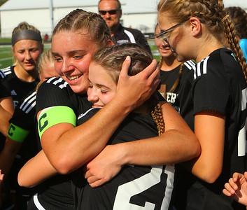 10-6-18 Western vs Marion girls soccer sectional championship Samantha Garber hugs Sophie Norfleet (21) after the win. Kelly Lafferty Gerber | Kokomo Tribune