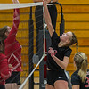 Logansport sophomore Mayce McClure (3) tucks the ball over the net as the Lady Berries defeated the Lady Redskins of Knox in four sets on Wednesday night. Fran Ruchalski | Pharos-Tribune