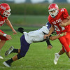 9-14-18<br /> Lewis Cass vs Northwestern football<br /> LC's Gabe Eurit looks to outrun NW's Bodey Henry.<br /> Kelly Lafferty Gerber | Kokomo Tribune