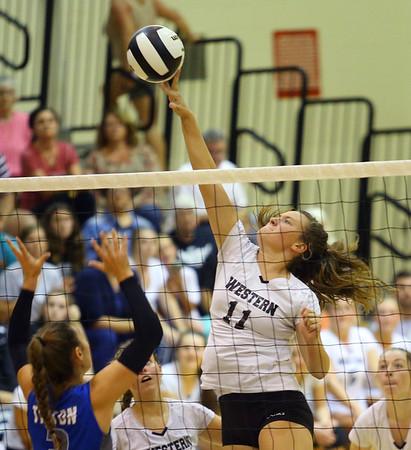 9-5-18<br /> Western vs Tipton volleyball<br /> Emma Key tips the ball over the net.<br /> Kelly Lafferty Gerber | Kokomo Tribune