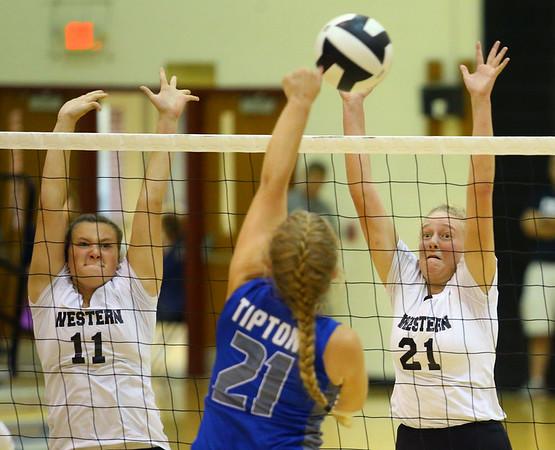9-5-18<br /> Western vs Tipton volleyball<br /> Western's Emma Key and Hilary Merica go for a block.<br /> Kelly Lafferty Gerber | Kokomo Tribune