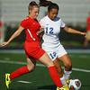 9-15-18<br /> Mac vs KHS girls soccer<br /> Mac's Courtney Grant and Kokomo's Vicky Qiu.<br /> Kelly Lafferty Gerber | Kokomo Tribune