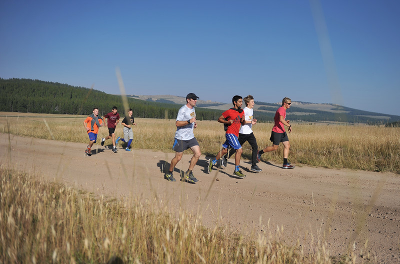 Bud Denega | The Sheridan Press<br /> Sheridan High School runners train during their annual mountain camp at 4-H Campground near Burgess Junction Thursday, August 16, 2018.