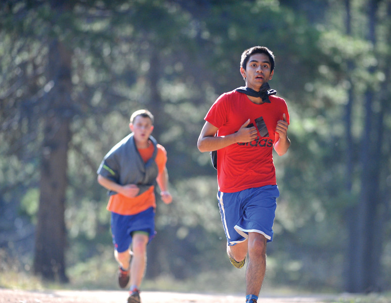 Bud Denega | The Sheridan Press<br /> Carlos Hernandez runs during the Sheridan High School cross-country team's annual mountain camp Thursday, August 16, 2018.