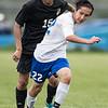 Jacob Noftsinger moves the ball past Monicello's  Norberto Jara-Castillo