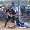 Kaitlyn Fletcher dives to get back to first base after Serenity Bishop caught a short fly ball from Kirsten Fletcher