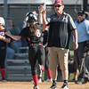 Coach Dovel high fives #8 as she heads for home plate