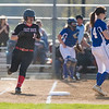 Samantha Hensley makes her way to first base.