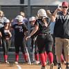 Coach Dovel congratulates Autumn Bailey for a hitting a home run
