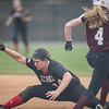 Samantha Hensley stretches to catch the ball to make the play at first as Morgan Adams charges her way to the base