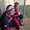 Samantha Hensley and Serenity Bishop watch from the dugout
