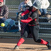 Pitcher Samantha Hensley connects with the ball for a double.