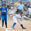 Kaitlyn Fletcher makes the catch as Lydia Landes charges towards first base
