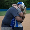 Coach Hand and Coach Lewellen share a hug after a touching speach from Coach Hand.