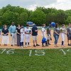 Seniors and their families listen as Coach Hand addresses them.
